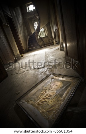 An illustration of a religious person laying broken on the floor at this creepy scenery. - stock photo