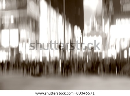 An illustrative motion blurred image of city life a night - stock photo