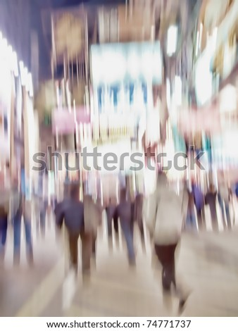 An illustrative motion blurred image of city life a night in Hong Kong - stock photo