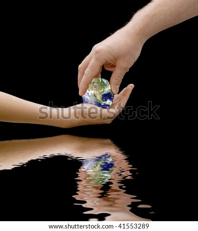 an image depicting a father passing the world to his offspring, the concept being our children inherit the world, with flood water. - stock photo