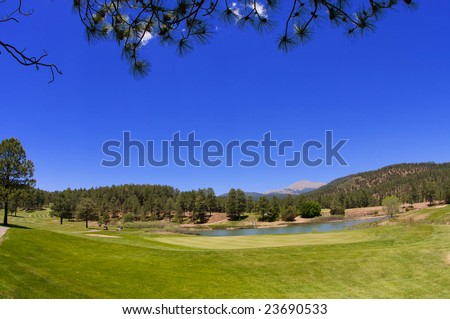 An image of a Arizona golf course with lush vegetation and mountain peaks - stock photo