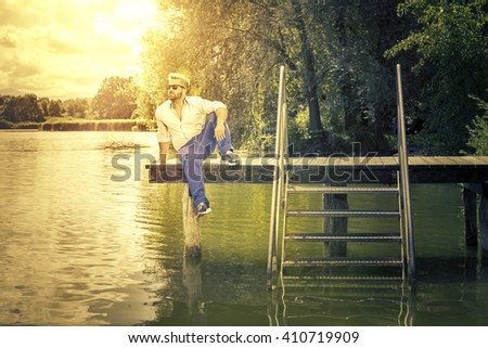 An image of a bearded man at the lake