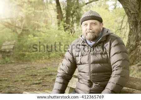 An image of a bearded man in winter jacket - stock photo