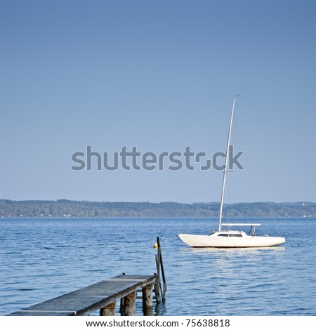An image of a beautiful boat and jetty at Starnberg lake