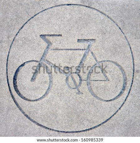 An image of a bicycle in a circle carved into stone, used to identify a cycle route