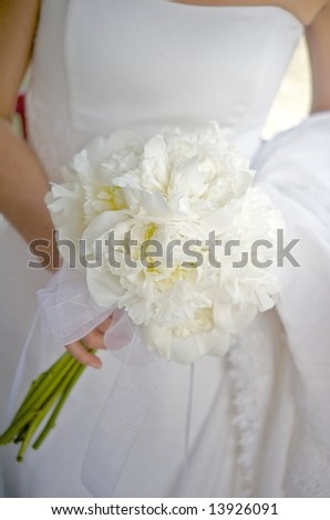 An image of a bride with her wedding bouquet - stock photo