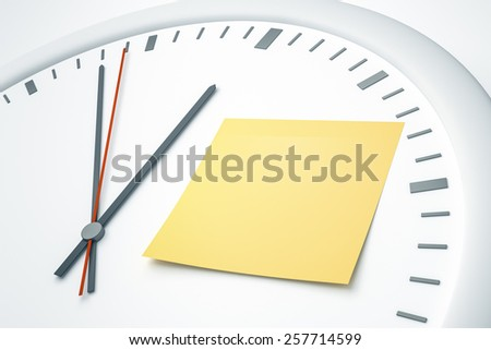 An image of a bright clock with a sticky note - stock photo