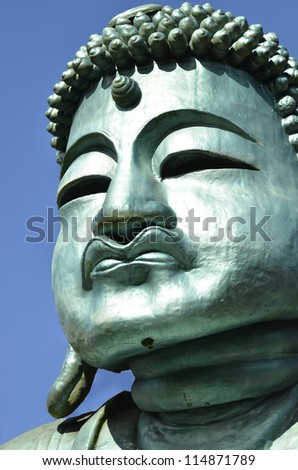 An image of a Buddha Statue - stock photo