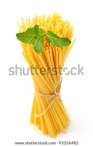 An image of a bunch of raw noodles and basil