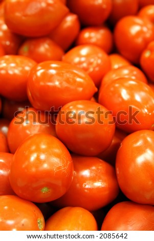 An image of a bunch of red tomatoes