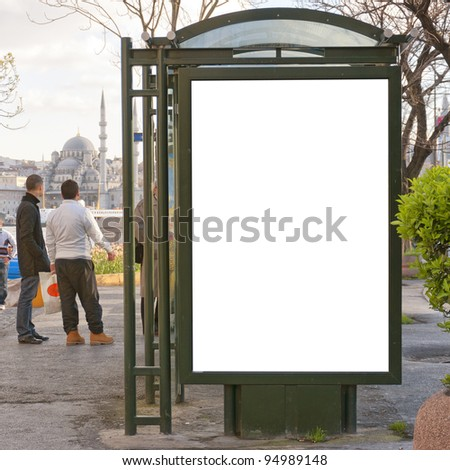 An image of a bus stop with a blank billboard for your advertising situated in the centre of Istanbul with a mosque in the background. - stock photo