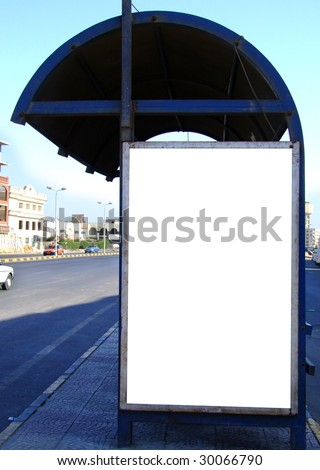 An image of a bus stop with a blank billboard for your advertising situated in the egyptian city of Hurghada. - stock photo