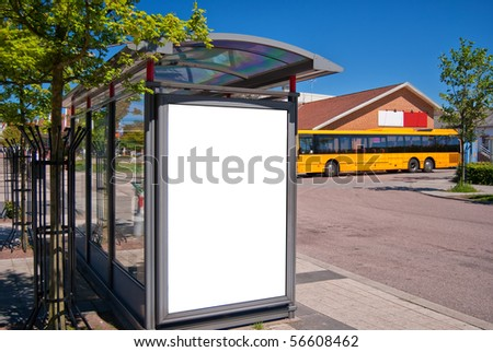 An image of a bus stop with a blank billboard for your advertising situated in the swedish town of Bastad. - stock photo