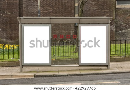 An image of a bus stop with blank bilboards for your advertising situated in the Scottish City of Glasgow. - stock photo