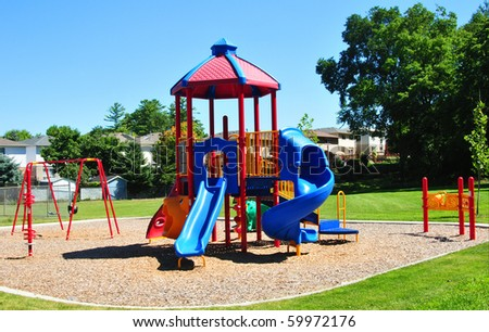 An image of a colorful children's playground in  suburban area. - stock photo