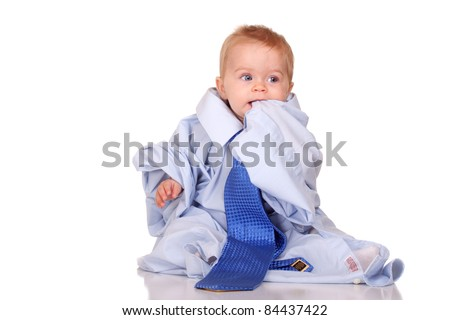 An image of a cute baby in a suit, wearing over sized clothes.  Images is isolated on white with reflection. - stock photo