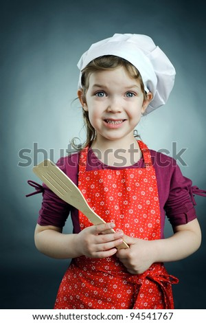 An image of a cute girl in white hat with a scapula - stock photo