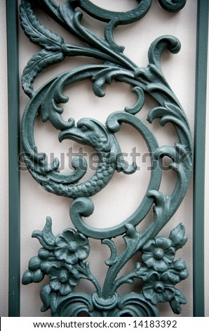 An image of a decorative metal trellis with floral scrolling - stock photo