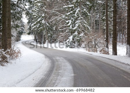 An image of a deep winter snowy road - stock photo