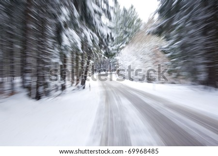 An image of a deep winter snowy road with a zoom - stock photo