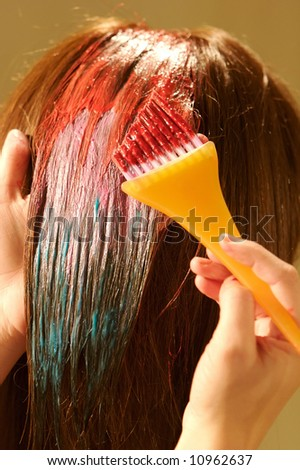 an image of a Female hair coloring at a salon - stock photo