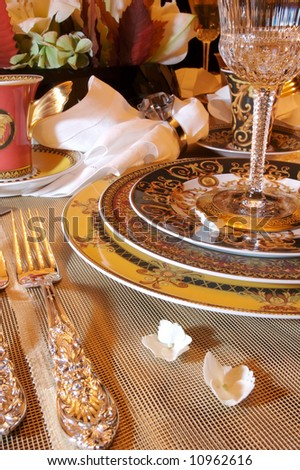 An Image Of A Formal Dining Room Place Setting
