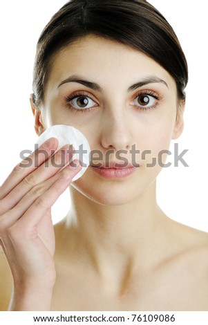 An image of a girl cleaning her face - stock photo