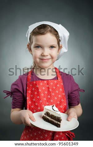 An image of a girl in a hat with a cake on a plate - stock photo