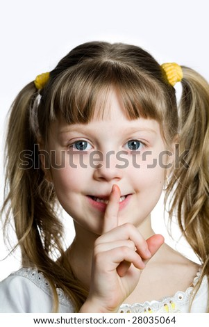 An image of a girl with a finger on her lips
