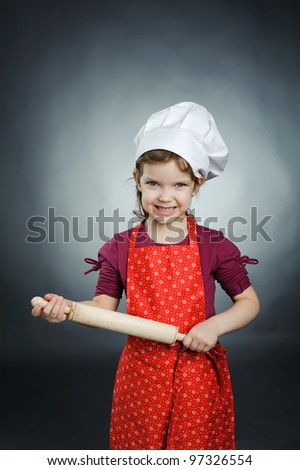 An image of a girl with a rolling pin in her hands