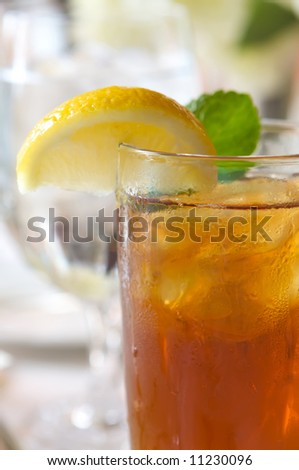 an image of a glass of ice tea on a sun drenched table
