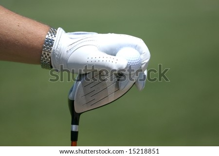 An image of a golfer's hand on a club - stock photo