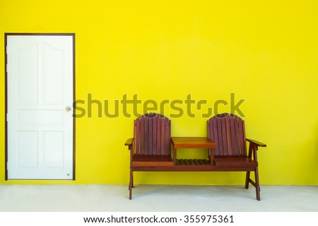 An image of a green room with white door and double chair wooden. - stock photo