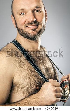 An image of a hairy man in bavarian tradition - stock photo