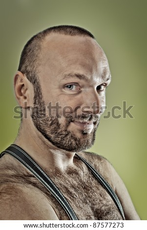 An image of a hairy man with a beard - stock photo
