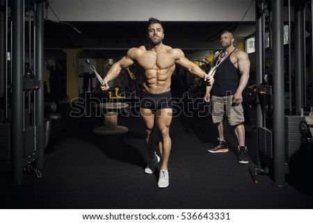 An image of a handsome bearded bodybuilding man