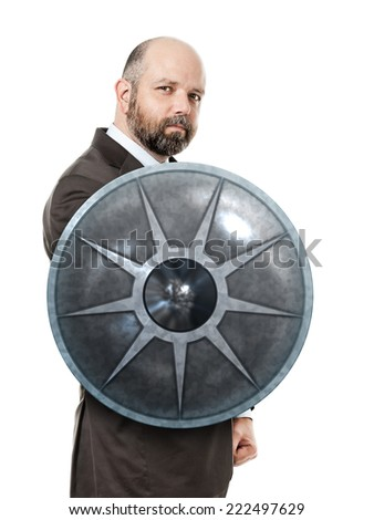 An image of a handsome business man with a shield - stock photo