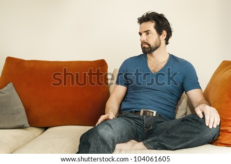 An image of a handsome but depressed man with a beard - stock photo