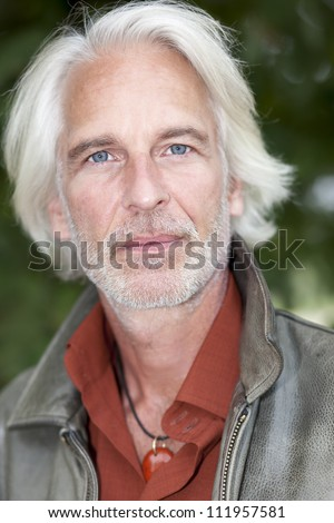 An image of a handsome male portrait with white beard - stock photo