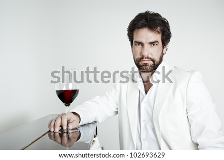 An image of a handsome man and a glass of red wine - stock photo