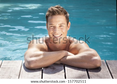 An image of a handsome man in the pool - stock photo