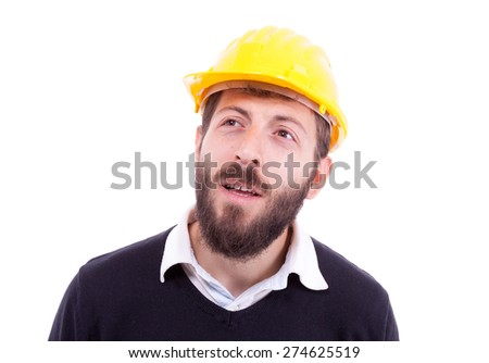 An image of a handsome man with a beard, construction helmet