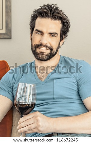An image of a handsome man with a glass of wine - stock photo