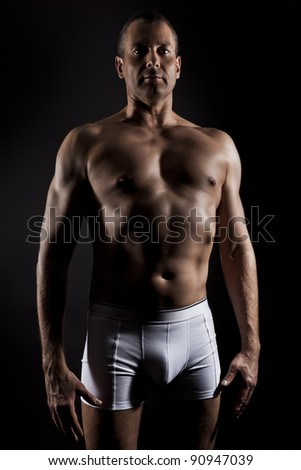An image of a handsome middle aged muscular sports man - stock photo