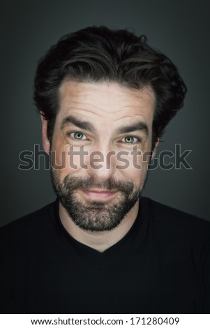 An image of a handsome smiling man with a beard