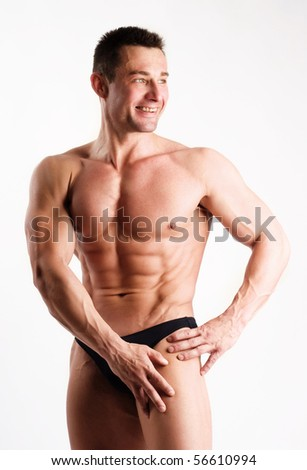 An image of a handsome strong man posing