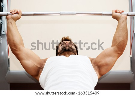 An image of a handsome young muscular sports man - stock photo