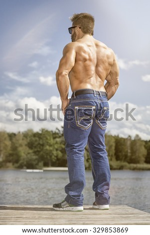 An image of a handsome young muscular sports man back