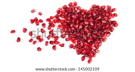 An image of a heart of pomegranate seeds - stock photo