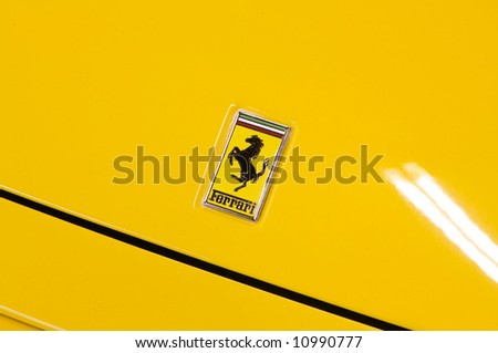 an image of a Italian sports car in yellow F355 Ferrari - stock photo